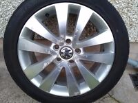 4 golf alloys 2 with new tryes 4 centre caps 17 inch