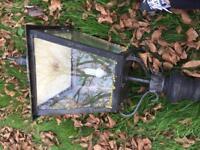 Cast iron lamp post with glass lantern