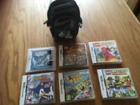 6 Nintendo DS games and a sonic the hedgehog bag