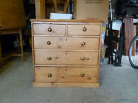 Antique pine chest of draws.