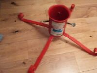 Red PVC coated steel Christmas tree stand, good condition.