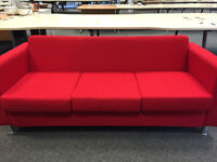 Pair of reception sofas in lipstick red!