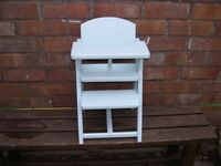A wooden dolls chair painted light blue.