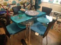 Glass table an 4 chairs mint condition