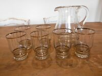 Glass and Gold pitcher and 6 glasses