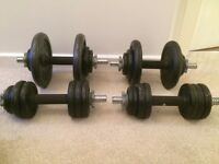 Set of four dumbbells. Metal weight plates