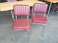 Retro diner style red dining chairs wooden topped table. Delivery available.