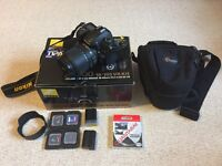 Nikon D7000 Digital SLR with 18 – 105mm VR lens and accessories