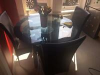 Glass table and 3 chairs