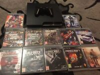 PlayStation 2 for sale with 12 games.