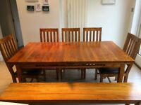 Solid wood extendable dining table with chairs and bench