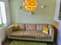 Bespoke handmade Sofa with Harlequin Lavida fabric