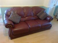 Maroon 2 piece leather sofa