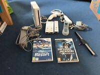 Nintendo Wii console with games and board