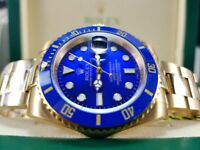 New and boxed gold bracelet and case blue bezel and face Rolex submariner watch automatic sweep