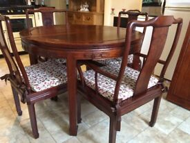 Chinese rosewood Table with 8 chairs.