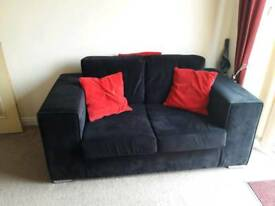 ** OFFERS** 2 Seater sofa VGC Finished in Black Velour with Stainless steel feet