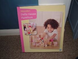 Box of wooden furniture for a child's dolls house