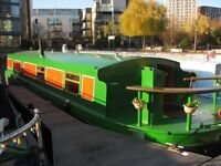 widebeam canal boat on residential London mooring