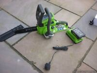 battery operated greenworks chainsaw with battery and charger