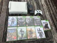 Xbox 360 console and call of duty games. COD