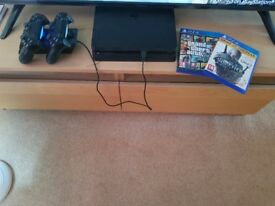 Playstation 4 + 2 controllers and dock with games.