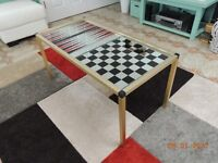 Mirror glass top with chess and backgammon settings on gold metal frame. Good condition.