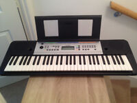 Yamaha YPT-255 digital keyboard c/w music book stand and ac adapter.