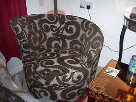 swivel tub chair swirl design never sat on. does not fit in with colour scheme.
