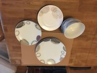 Modern plate set for sale. Excellent condition!