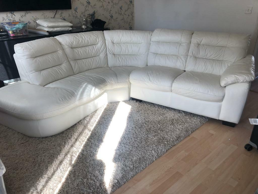 White Leather Corner Sofa And Round Swivel Chair In