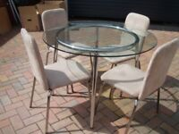 Glass and chrome table with 4 cream chairs