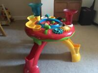 Ball activity table with hammer