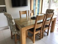 Solid Oak dining table with 6 chairs and custom made glass top protector
