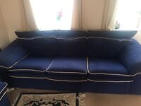 Blue sofa and foot rest