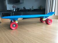 Genuine original Penny Board. Cyan Red. In excellent condition, barely used. RRP $120