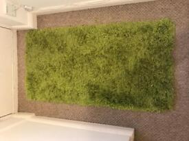 2 x green rugs