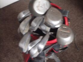 Full set up golf clubs with trolley.