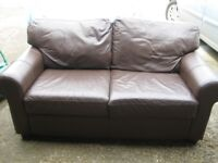 FREE- 2 seater brown leather sofa.