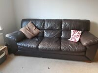 Brown leather sofa and arm chair. Used but still a good few years use remaining. See pictures