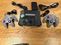Nintendo 64 console with two Official controllers