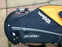 Wilson Nomad stand golf bag with rain hood.