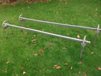 A PAIR OF GALVANISED FORD TRANSIT ROOF RACK BARS FITS IN MINUTES