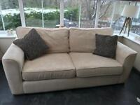 Sofa and matching swivelling snuggle chair