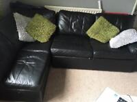 Black leather corner pull out sofa with storage