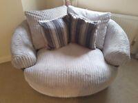 Swivel cuddler sofa chair