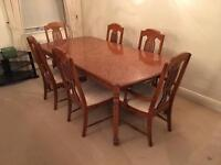 Large extending wood dining table and 6 chairs