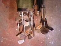 Old vintage golf clubs and bag