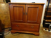Very nice T.V. Cabinet with retractable fold away doors and shelving