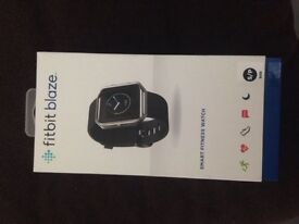 Brand new sealed Fitbit Blaze smart fitness watch Unwanted gift